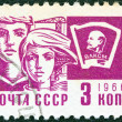 "USSR - CIRCA 1966: A stamp printed in USSR from the ""Society and Technology"" issue shows a young boy and girl and Lenin emblem, circa 1966. - Stock fotografie"