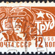 "USSR - CIRCA 1966: A stamp printed in USSR from the ""Society and Technology"" issue shows a Furnaceman, circa 1966. - Stock Photo"
