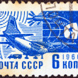 "Стоковое фото: USSR - CIRC1966: stamp printed in USSR from ""Society and Technology"" issue shows Antonov An-10Ukrainiairplane and sputnik, circ1966."
