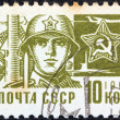 "USSR - CIRCA 1966: A stamp printed in USSR from the ""Society and Technology"" issue shows a soldier and star emblem, circa 1966. — Stock Photo"