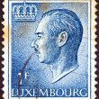 LUXEMBOURG - CIRCA 1965: A stamp printed in Luxembourg shows a portrait of Grand Duke Jean, circa 1965. - Stock Photo