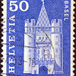 "SWITZERLAND - CIRCA 1960: A stamp printed in Switzerland from the ""Architectural Monuments (1st series)"" issue shows Spalentor gate, Basel, circa 1960. - Stock Photo"