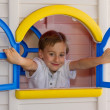 Stock Photo: Cute child playing in toy house