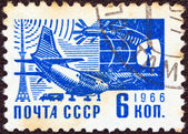 "USSR - CIRCA 1966: A stamp printed in USSR from the ""Society and Technology"" issue shows an Antonov An-10A Ukrainian airplane and sputnik, circa 1966. — Стоковое фото"
