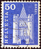"""SWITZERLAND - CIRCA 1960: A stamp printed in Switzerland from the """"Architectural Monuments (1st series)"""" issue shows Spalentor gate, Basel, circa 1960. — Stock Photo"""