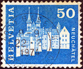 "SWITZERLAND - CIRCA 1964: A stamp printed in Switzerland from the ""Architectural Monuments (2nd series)"" issue shows Neuchatel Castle and Collegiate Church, circa 1964. — Stock Photo"