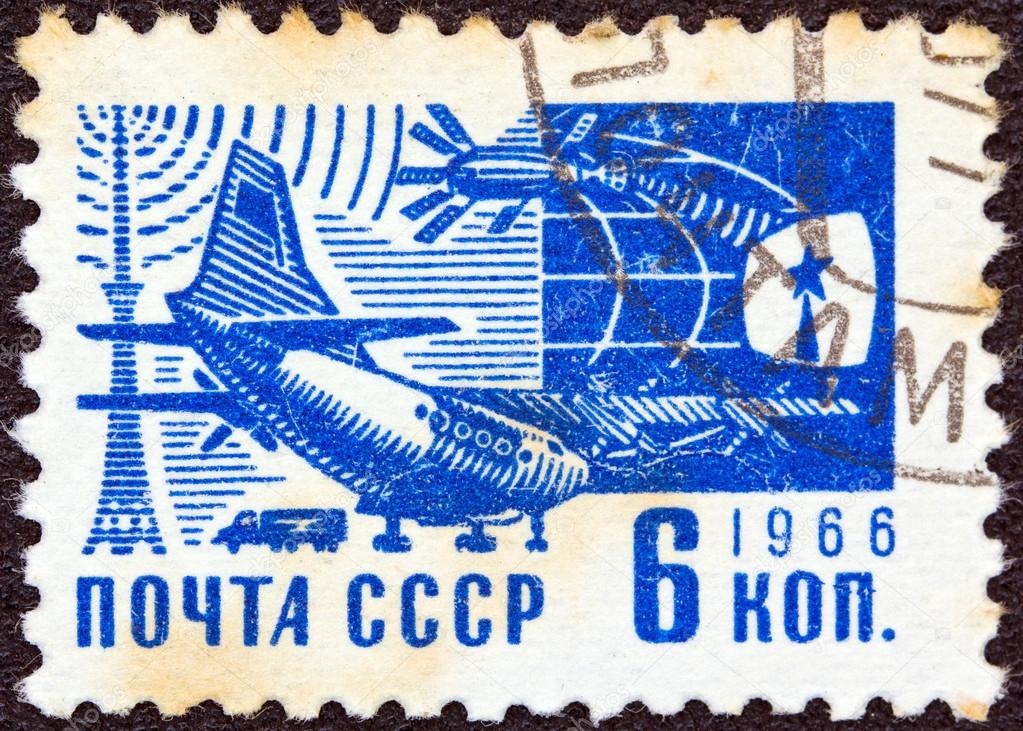 USSR - CIRCA 1966: A stamp printed in USSR from the &quot;Society and Technology&quot; issue shows an Antonov An-10A Ukrainian airplane and sputnik, circa 1966.   Stock Photo #12362183