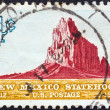 USA - CIRCA 1962: A stamp printed in USA issued for the 50th anniversary of Statehood of New Mexico shows Shiprock, New Mexico, circa 1962. — Stock Photo