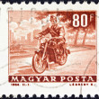 "HUNGARY - CIRCA 1963: A stamp printed in Hungary from the ""Transport and Communications"" issue shows a Motorcyclist, circa 1963. - Stock Photo"