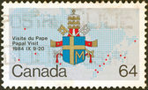 "CANADA - CIRCA 1984: A stamp printed in Canada from the ""Papal Visit"" issue shows the Coat of Arms of Pope John Paul II, circa 1984. — Stock Photo"
