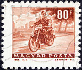 """HUNGARY - CIRCA 1963: A stamp printed in Hungary from the """"Transport and Communications"""" issue shows a Motorcyclist, circa 1963. — Stock Photo"""