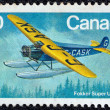 "CANADA - CIRCA 1982: A stamp printed in Canada from the ""Canadian Aircraft (4th series)"" issue shows a Fokker super universal airplane, circa 1982. — Stock Photo"