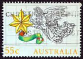 AUSTRALIA - CIRCA 1985: A stamp printed in Australia issued for Christmas shows an Angel with a star, circa 1985. — Stock Photo