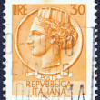 "ITALY - CIRCA 1953: A stamp printed in Italy from the ""Italy turreted (Syracuse)"" issue shows an Ancient coin of Syracuse, circa 1953. — Stock Photo #12673744"