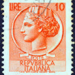 "ITALY - CIRCA 1953: A stamp printed in Italy from the ""Italy turreted (Syracuse)"" issue shows an Ancient coin of Syracuse, circa 1953. — Stock Photo #12673792"