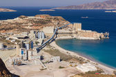 Large bentonite and perlite processing plant by the sea — Stock Photo