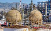 Storage tanks in oil refinery — Stock Photo