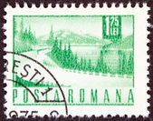 ROMANIA - CIRCA 1967: A stamp printed in Romania shows a Lakeside highway, circa 1967. — Stock Photo