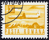 ROMANIA - CIRCA 1967: A stamp printed in Romania shows an Ilyushin Il-18 airliner, circa 1967. — Zdjęcie stockowe