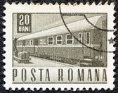 ROMANIA - CIRCA 1967: A stamp printed in Romania shows a Railway traveling post office coach, circa 1967. — Stock fotografie