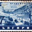 "BULGARIA - CIRCA 1942: A stamp printed in Bulgaria from the ""Work and Joy"" issue shows a bugler at camp, circa 1942. - Stock Photo"