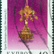 "CYPRUS - CIRCA 2000: A stamp printed in Cyprus from the ""Jewellery"" issue shows a golden earring (early 19th century A.D.), circa 2000. — Stock Photo"