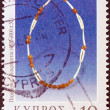 "CYPRUS - CIRCA 2000: A stamp printed in Cyprus from the ""Jewellery"" issue shows a necklace from Khirokitia (4.500-4.000 B.C.), circa 2000. — Stock Photo"