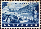 "BULGARIA - CIRCA 1942: A stamp printed in Bulgaria from the ""Work and Joy"" issue shows a bugler at camp, circa 1942. — Stock Photo"