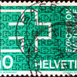 SWITZERLAND - CIRCA 1963: A stamp printed in Switzerland issued for the Swiss National Exhibition, Lausanne shows Exhibition Emblem, circa 1963. — Stock Photo