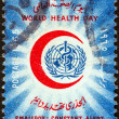 Foto Stock: EGYPT - CIRC1965: stamp printed in Egypt issued for world health day shows World Health Organization emblem within Red Crescent, circ1965.