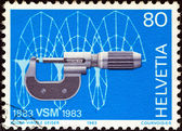 SWITZERLAND - CIRCA 1983: A stamp printed in Switzerland issued for the centenary of Swiss machine manufacturers' association shows Micrometer and cycloidal computer drawing, circa 1983. — Stock Photo