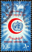 EGYPT - CIRCA 1965: A stamp printed in Egypt issued for the world health day shows World Health Organization emblem within Red Crescent, circa 1965. — Stock Photo