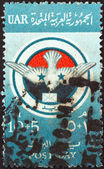 EGYPT - CIRCA 1959: A stamp printed in Egypt issued for the Post Day and Postal Employees Social Fund shows Egyptian Postal Emblem, circa 1959. — Stock Photo