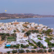 August full moon rise, Adamantas, Milos island, Cyclades, Greece - Stock Photo