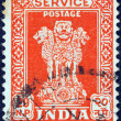 INDIA - CIRCA 1957: A stamp printed in India shows four Indian lions capital of Ashoka Pillar, circa 1957. — Stock Photo #13097436