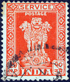 INDIA - CIRCA 1957: A stamp printed in India shows four Indian lions capital of Ashoka Pillar, circa 1957. — Photo