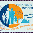 INDONESIA - CIRCA 1969: A stamp printed in Indonesia issued for South-East Asia and Oceania Family Planning Conference shows a family and a factory, circa 1969. — Stock Photo
