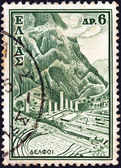 """GREECE - CIRCA 1961: A stamp printed in Greece from the """"Tourist Publicity"""" issue shows the archaeological site of Delphi, circa 1961. — Stock Photo"""