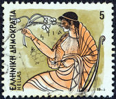 """GREECE - CIRCA 1986: A stamp printed in Greece from the """"Gods of Olympus"""" issue shows goddess Hestia, circa 1986. — Stock Photo"""