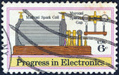 "USA - CIRCA 1973: A stamp printed in USA from the ""Progress in Electronics"" issue shows Marconi's Spark Coil and Gap (1901), circa 1973. — Stock Photo"