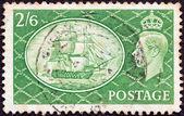 UNITED KINGDOM - CIRCA 1951: A stamp printed in United Kingdom shows HMS Victory and King George VI, circa 1951. — Stock Photo