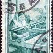 "ITALY - CIRCA 1950: A stamp printed in Italy from the ""Provincial Occupations"" issue shows a Weaver (Calabria), circa 1950. — Stock Photo"