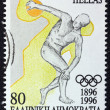 Stock Photo: GREECE - CIRC1996: stamp printed in Greece issued for 100th anniversary of modern Olympic Games shows ancient discus thrower athlete, circ1996.