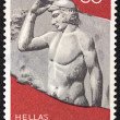 "GREECE - CIRCA 1972: A stamp printed in Greece from the ""Olympic Games, Munich"" issue shows a sculpture of an ancient athlete putting an olive wreath at it's head, circa 1972. — Stock Photo #13499089"