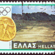 "GREECE - CIRCA 1980: A stamp printed in Greece from the ""Olympic Games, Moscow. Designs showing Greek stadia"" issue shows Olympia and coin of Elia, circa 1980. — Stock Photo"