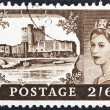 "UNITED KINGDOM - CIRCA 1955: A stamp printed in United Kingdom from the ""Castles"" issue shows Carrickfergus Castle and queen Elizabeth II, circa 1955. — Stock Photo"