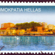 "GREECE - CIRCA 2004: A stamp printed in Greece from the ""Island Views"" issue shows a panorama of Chania city harbor, Crete island, circa 2004. — Stock Photo #13499445"