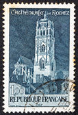 FRANCE - CIRCA 1967: A stamp printed in France shows Rodez cathedral, circa 1967. — Stock Photo