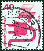 "GERMANY - CIRCA 1971: A stamp printed in Germany from the ""Accident Prevention"" issue shows a faulty electric plug, circa 1971. — Stock Photo"