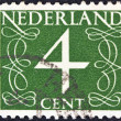 Royalty-Free Stock Photo: NETHERLANDS - CIRCA 1946: A stamp printed in the Netherlands shows it's value of 4 cent, circa 1946.